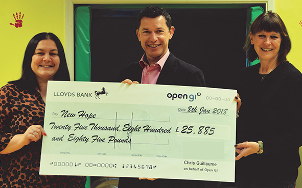 Chris Guillaume Group CEO Open GI presents cheque to New Hope