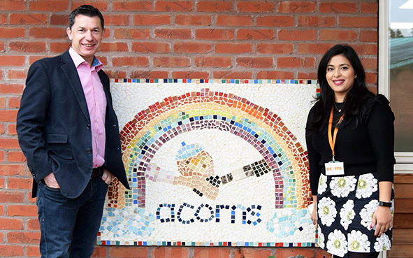 Open GI's CEO Chris Guillaume (L) with Acorns' Natalia Solanki (R) announcing the new charity partnership