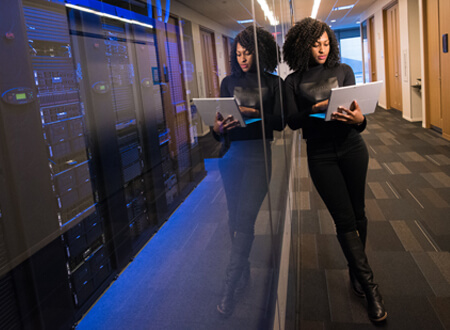 Lady with laptop outside server room - Digital Transformation - Technology Talk