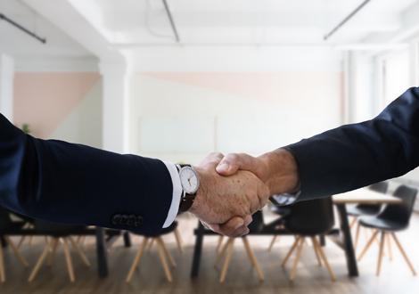 Men shaking hands - New business acquisition - Technology Talk