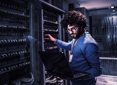 Man-in-front-of-server-AI-in-insurance-Featured-Image-Template